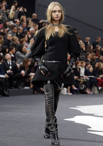 British model Cara Delevingne presents a creation by German designer Karl Lagerfeld for French fashion house Chanel as part of his Fall-Winter 2013/2014 women's ready-to-wear fashion show during Paris fashion week March 5, 2013. REUTERS/Charles Platiau (FRANCE - Tags: FASHION)